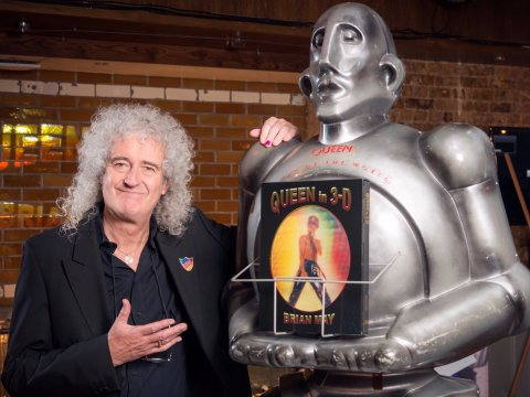 Brian May with a copy of his new bookt by Phil Harmer