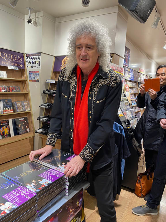 Brian with stack of Queen In 3-D books, Tower Records, Tokyo